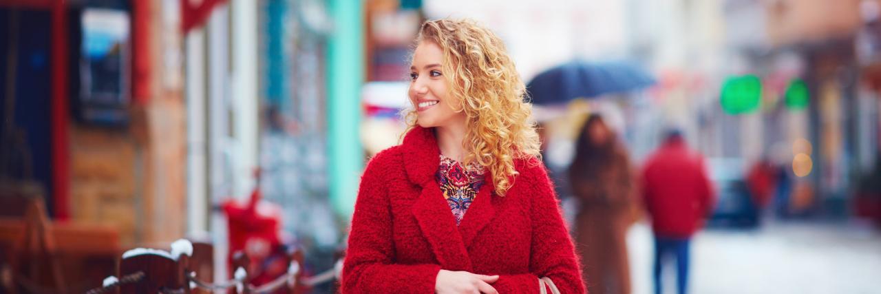 woman smiling in snowy winter street