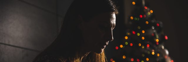 Lonely women sitting at home during christmas