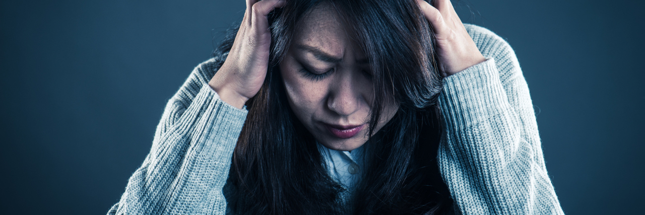 middle age asian woman distress