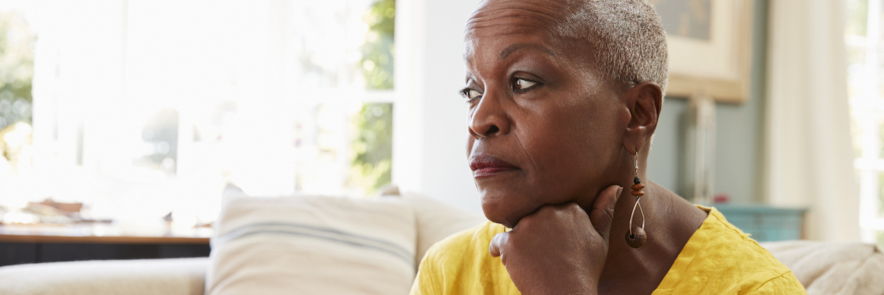 older woman looking sad