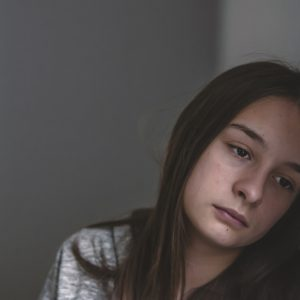 Lonely depressed woman feel tired, sad and unhappy. Portrait of a sad teenage girl looking thoughtful about troubles. Emotional portrait of a sad girl. Photo of Expression of lonely female teenager at home
