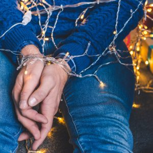 cropped shot of man tied up with christmas garland
