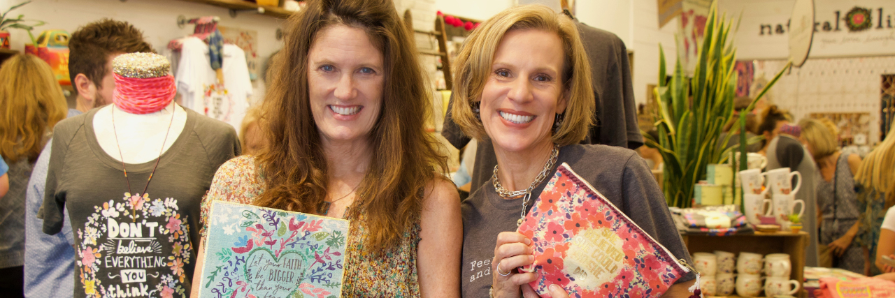 two women holding product from the Natural Life Fearless collection