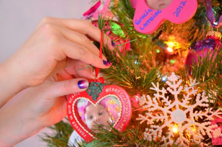 hanging ornament with a picture of a baby on the tree