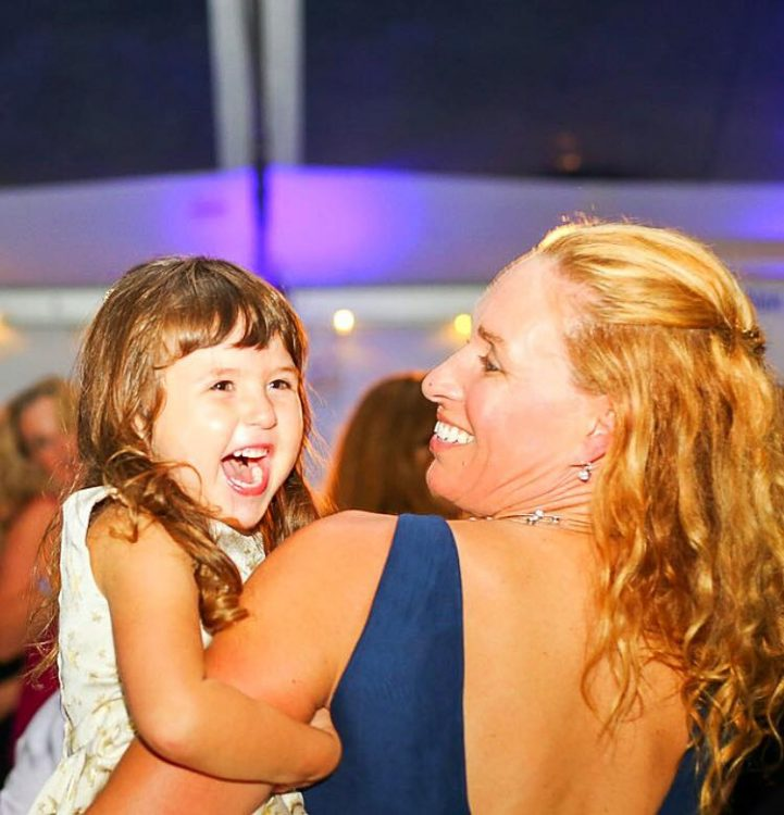 the author and her daughter smiling and dancing
