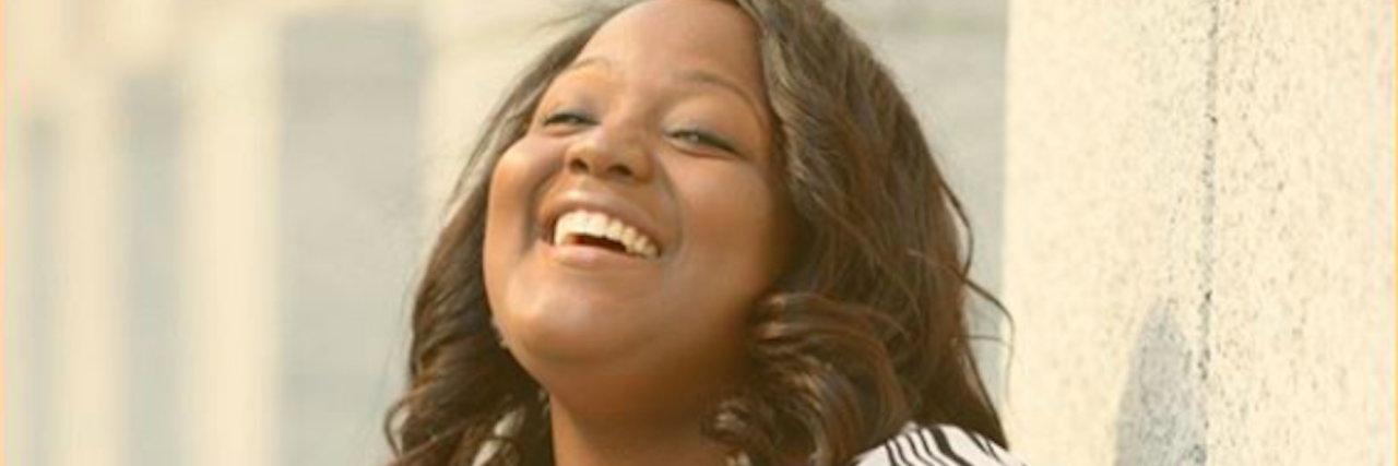 portrait of black woman smiling and laughing
