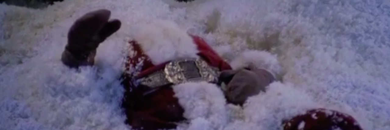 santa lying on the ground covered in snow