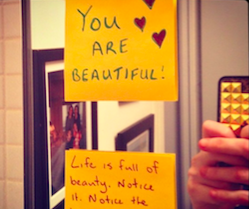 "Two post-it notes. One reads, ""You are beautiful"" - with hearts drawn in the corner. The second one reads, ""Life is full of beauty. Notice it."""