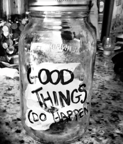 "A jar written on with a Sharpie, ""Good Things (Do Happen)."""