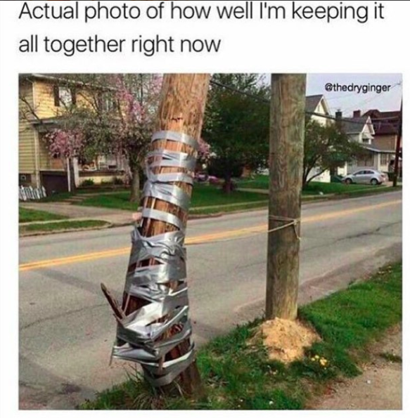 telephone pole being held together with duct tape