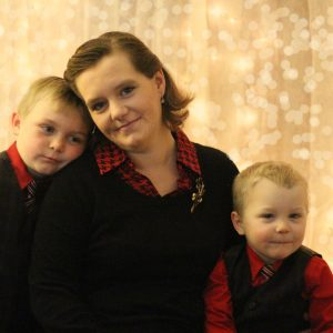 christmas photo of mother and two sons