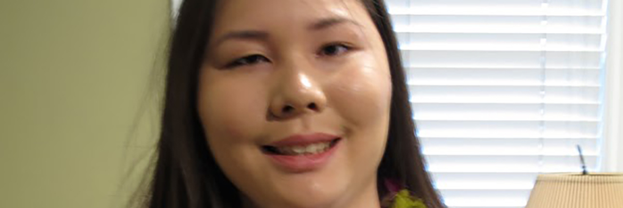Christine Motokane, young Asian-American woman wearing Hawaiian lei.