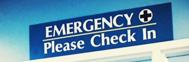 A check-in sign for an emergency room.