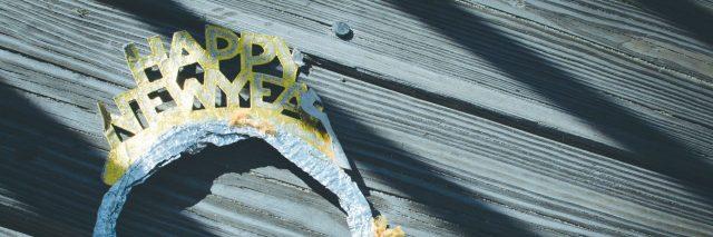 happy new year tiara on wooden deck or floor