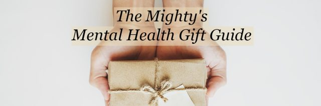A person holding a gift in their hands. Text reads: The Mighty's mental health gift guide