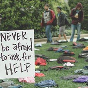 "backpacks on ground of college campus for the ""Send Silence Packing"" project"