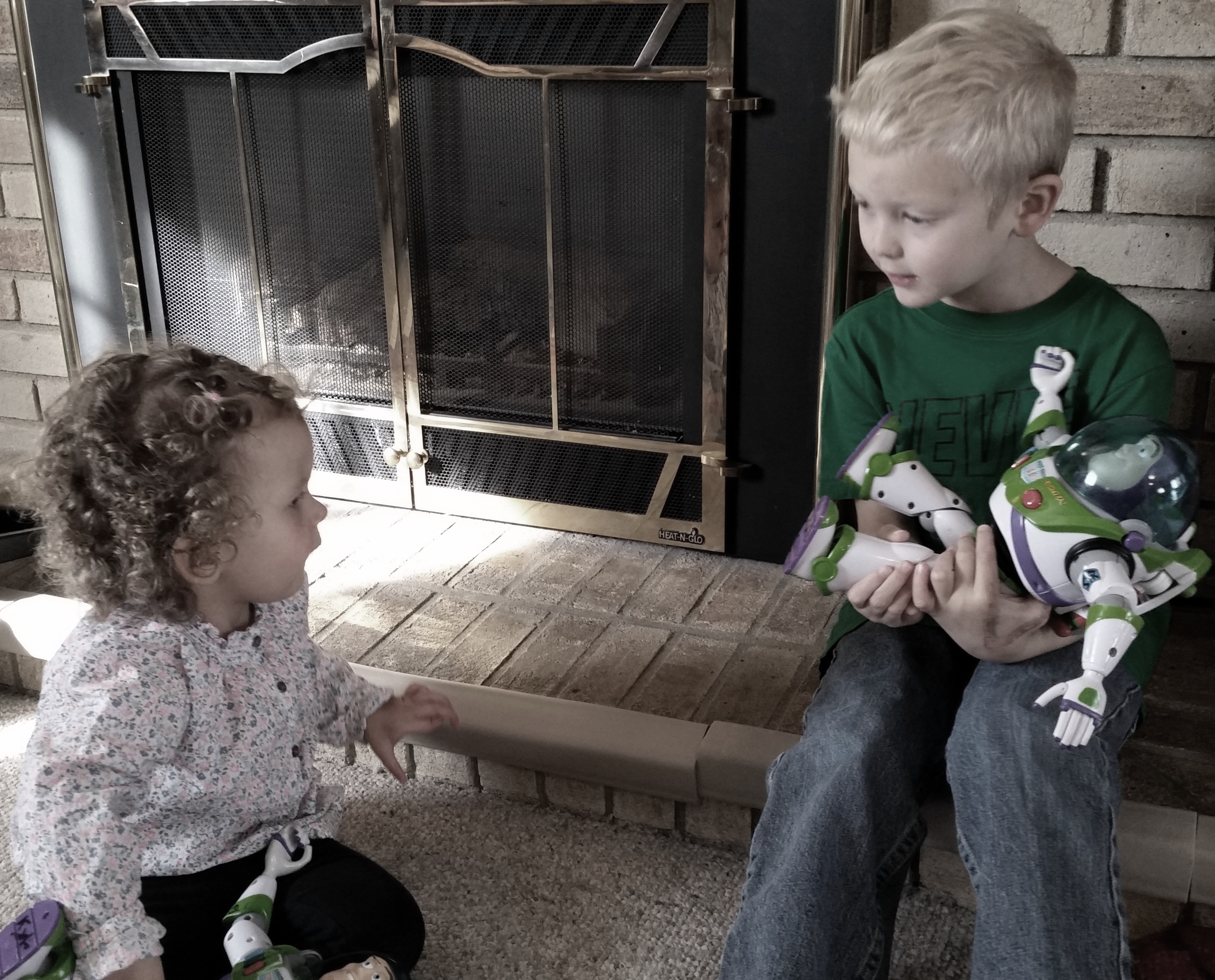 brother and sister playing with buzz lightyear
