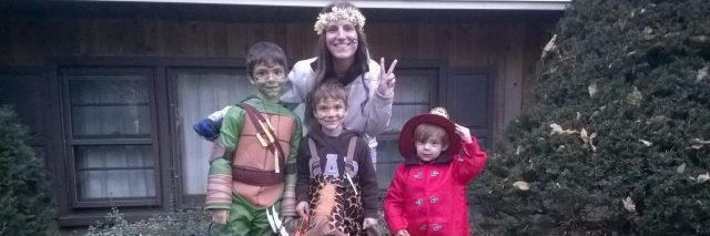 The writer with her three children on Halloween.