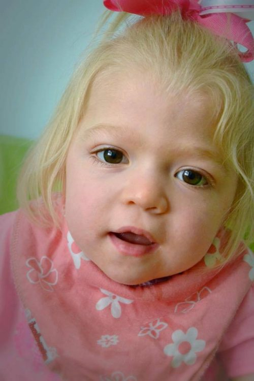 Willow Cannan looking at camera in a pink sweater