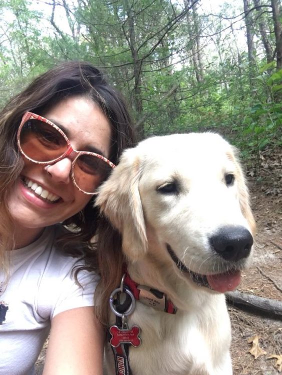 woman wearing sunglasses smiling with dog