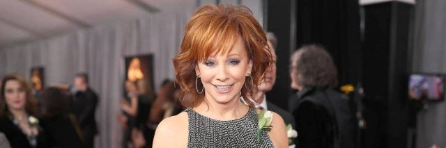 reba mcentire at the grammys wearing a white rose