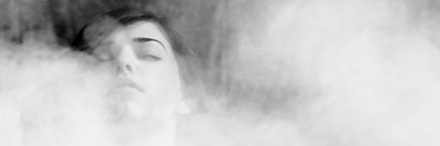 A woman being overcome by fog.
