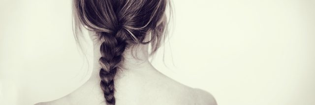 Girl or woman with braid from behind