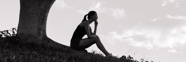 Stressed and depressed woman in the park.