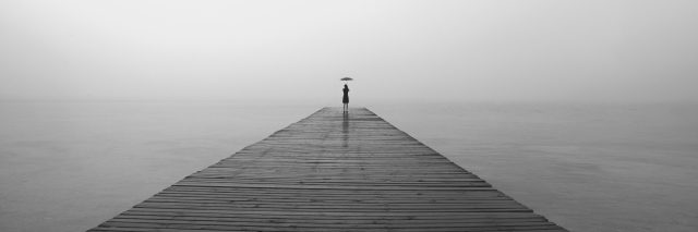 woman with black umbrella looking infinity in a surreal place