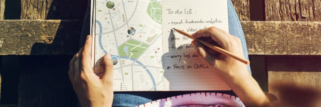 woman with map and notebook planning adventure