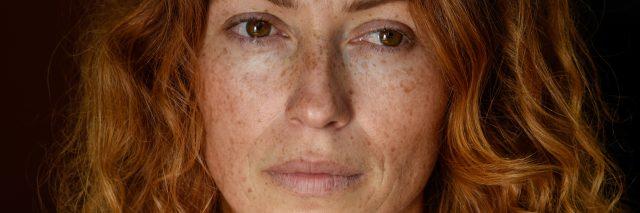 Portrait of redhead melancholic woman