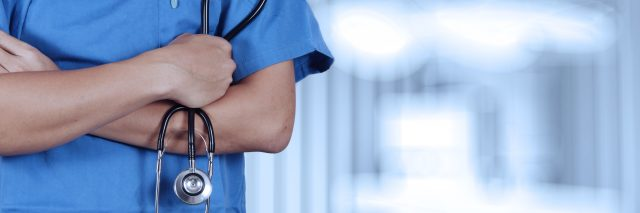 Nurse holding stethoscope.