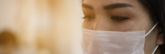 woman wearing mask to protect from being sick