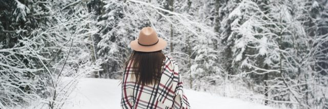 Young woman traveler in hat and scarf hold map in hand. Boho style