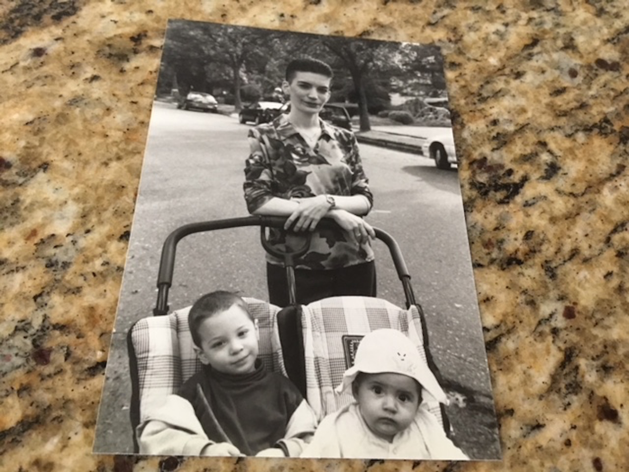 A photo of the writer and her two kids in the stroller.