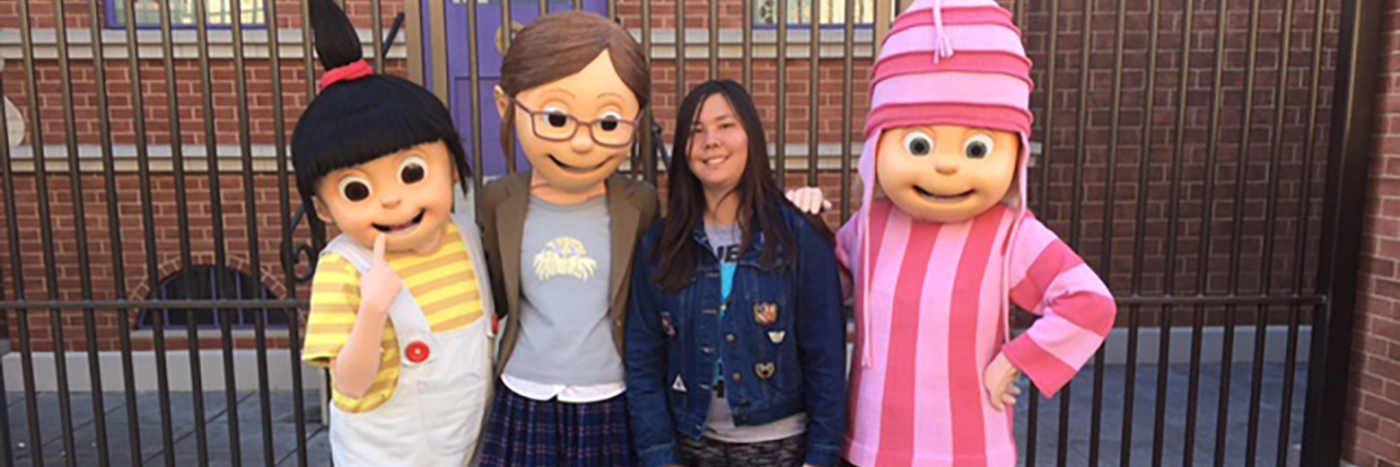 """Christine posing wth characters from """"Despicable Me."""""""