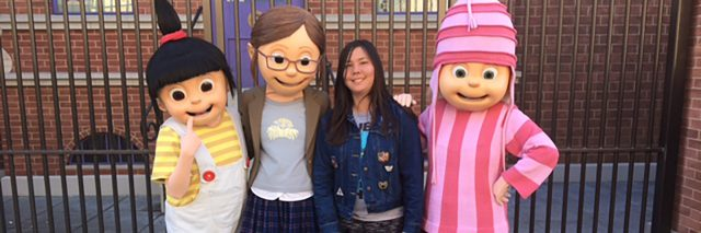 "Christine posing wth characters from ""Despicable Me."""