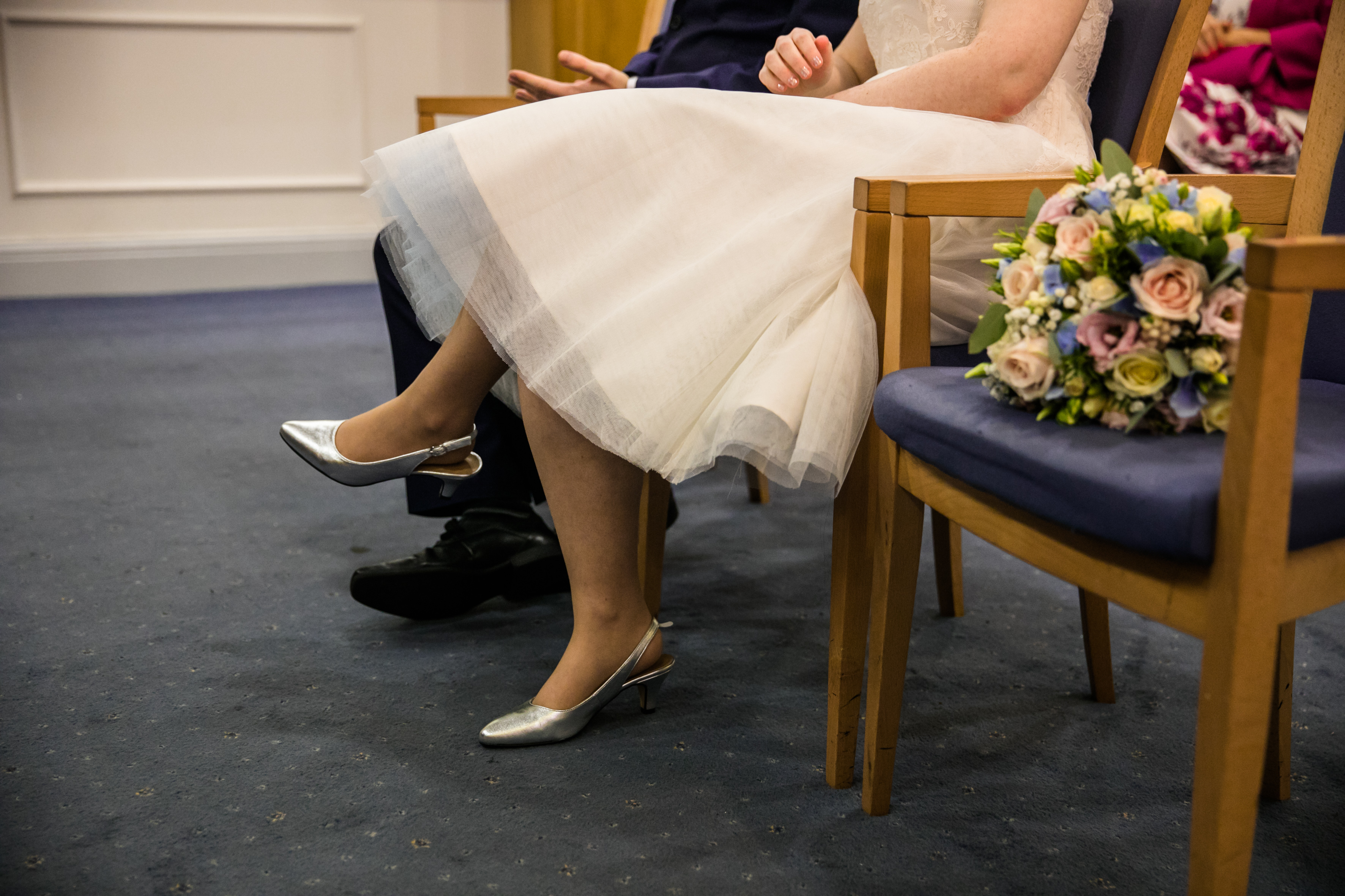 man and woman seated during their wedding ceremony