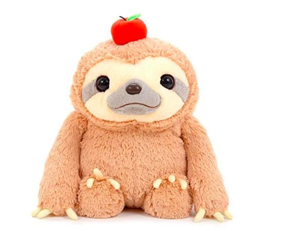 plush sloth with apple on head