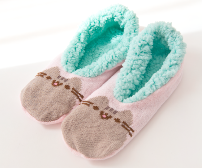slipper socks with teal interior and pusheen cat design on top