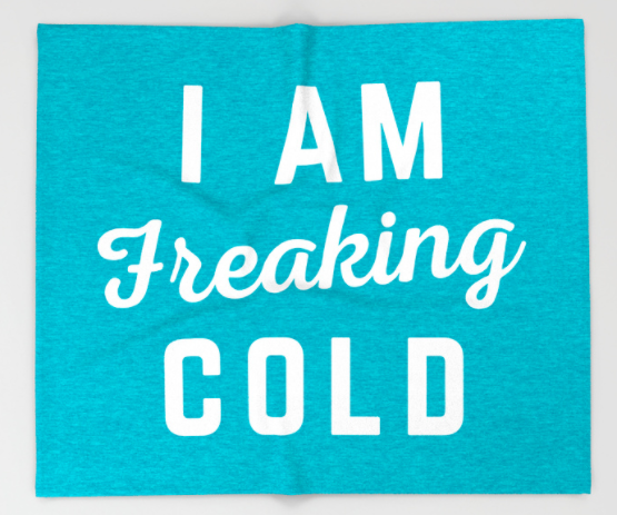 blue blanket with white letters I am freaking cold