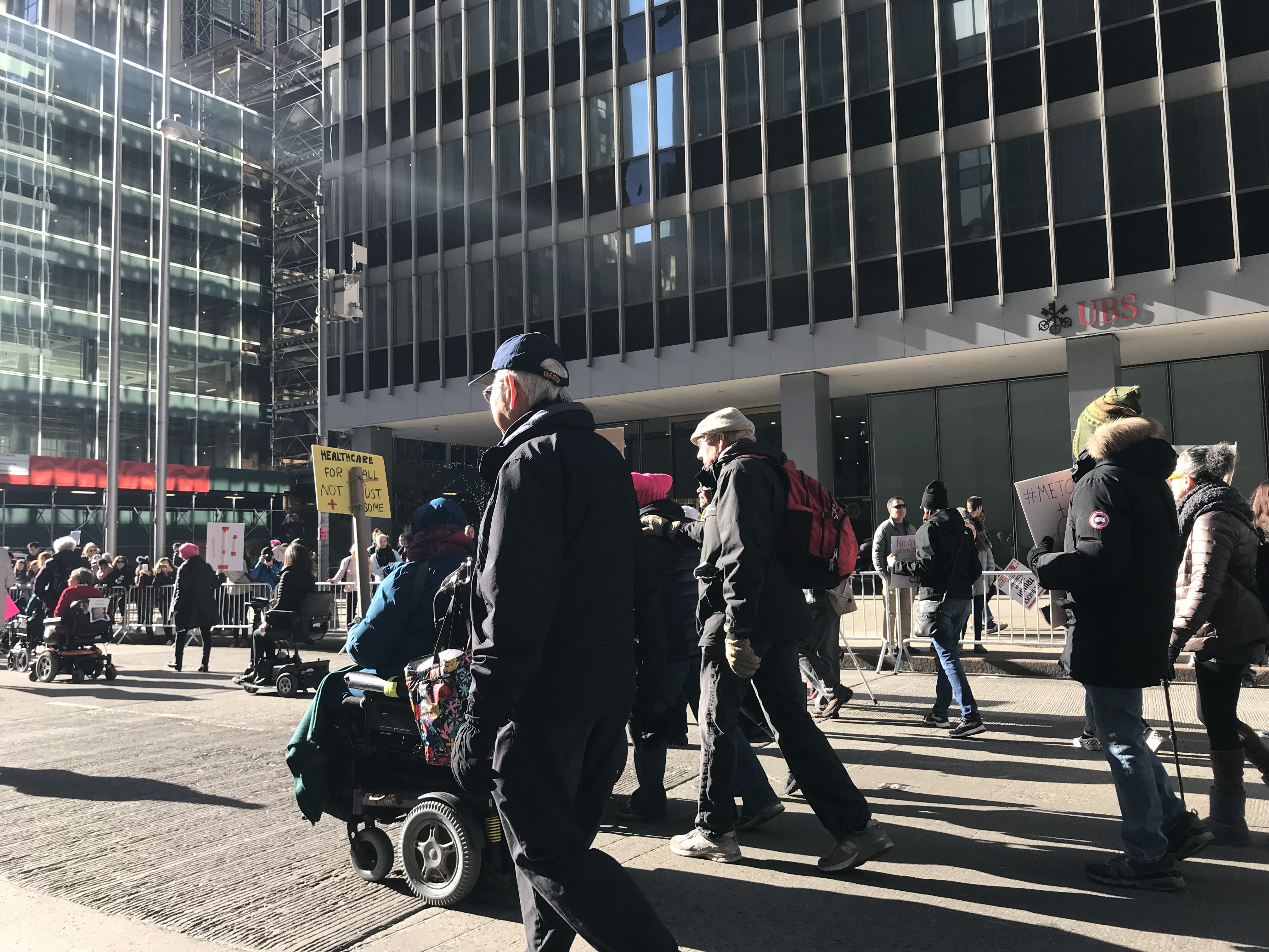 people in wheelchairs at the 2018 women's march in new york city