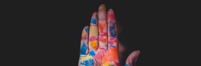 a hand covered in paint