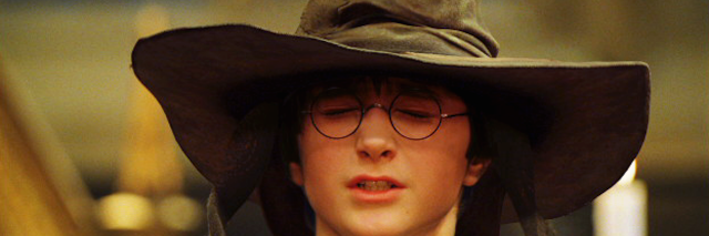 Harry Potter wearing the hat to sort him in a Hogwarts house.