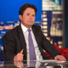 A photo of Michael J. Fox at a TV show desk.