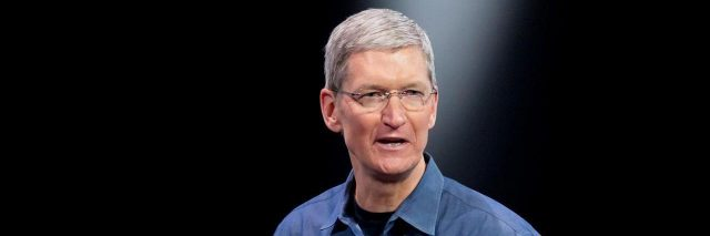 Image of Tim Cook giving a presentation wearing a dark blue shirt