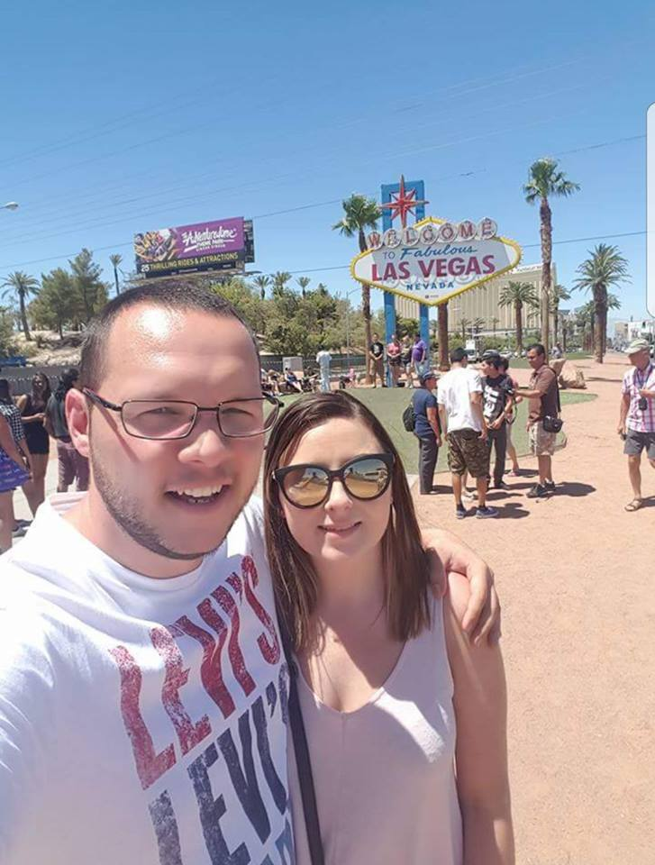 man and woman standing outside wearing sunglasses in las vegas