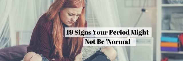 19 Signs Your Period Might Not Be 'Normal' text over woman sitting on bed holding stomach
