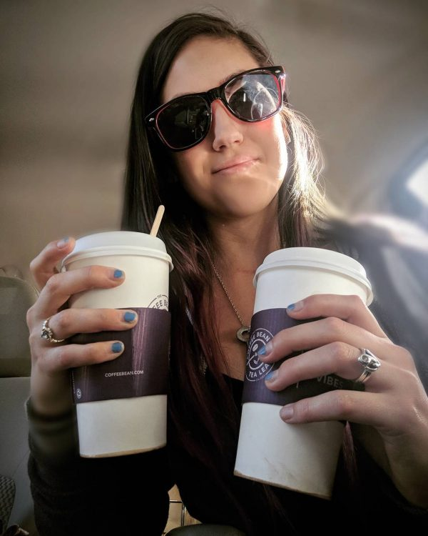 ashley kristoff holding two coffee cups