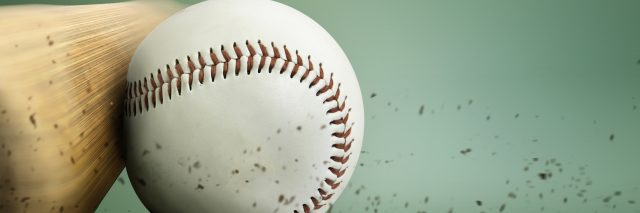 A baseball bat hitting a baseball.